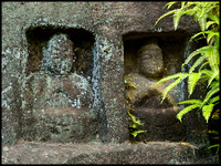 Two buddhas outside cave