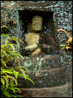 Buddha outside cave