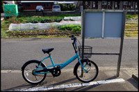 Blue bicycle and sign
