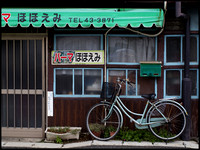 Bicycle and green awning