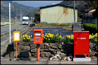 Timetable, post box and fire hose