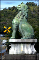 Guardian lion at railway crossing
